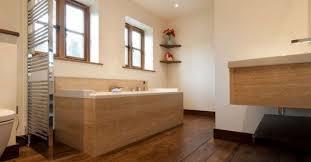 minimalist bathroom with white walls and bamboo bathroom flooring