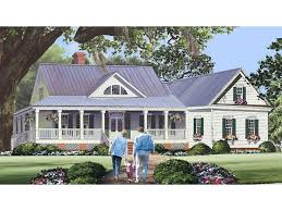 country homes cape cod style home with farmers porch two car garage and large