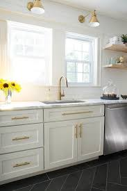 white kitchen cabinets with gold pulls white and gold kitchen with schoolhouse electric princeton