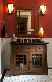craftsman style light switches a beautiful red craftsman style bathroom i love the wall sconces