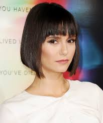 how do you cut a bob hairstyle nina dobrev just got bangs and an angled bob instyle com
