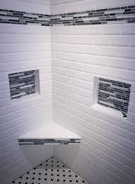 remodeled shower walls done in on trend white subway tile black