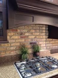 Stone Tile Kitchen Backsplash by Terrific Natural Stone Tile Kitchen Backsplash With Black Iron