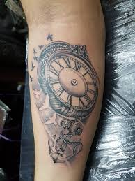 grey ink flying birds and anchor pocket watch tattoo on arm sleeve