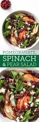 spinach and pear salad with pomegranate and candied pecans fork