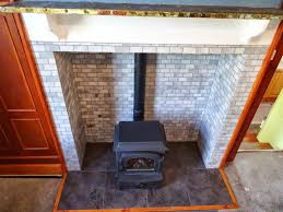 the history of a farmhouse fireplace and a british ceramic tile