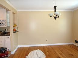 ceiling wooden baseboard molding mathed with white wall looks