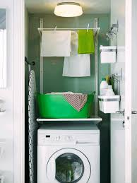 bathroom laundry room white hanging wooden box natural pebbles