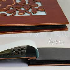 black wedding guest book tree on brown wooden wedding guest book with stylish laser cut