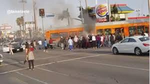 7 hurt as out of service la bus car crash catch fire wham