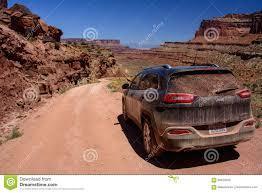 moab jeep trails moab utah usa june 15 2015 jeep cherokee on a white rim road