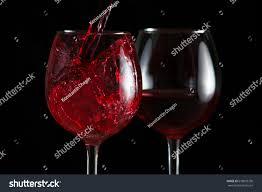 beautiful splash red wine glass on stock photo 678093730