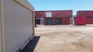 20ft one trip shipping container with a 16ft side roll up door