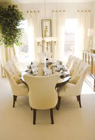 126 custom luxury dining room interior designs bright sunny dining room with oval wood table and eight plush cream colored dining chairs