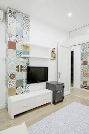 architecture cozy interior design with lovely decoration for your lovely wall decoratioon of colorful sticker and white cabinet also flat screen tv and wooden