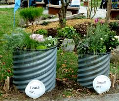 Herb Garden Planters by I Love The Idea Of Having Different Garden Beds Barrels For The