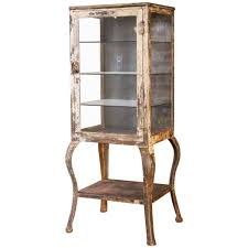 early 1900s steel and glass apothecary medical cabinet with