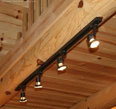 rustic track lighting fixtures rustic log home lighting bargains fun time logs and cabin