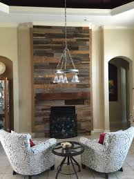 s reclaimed wood accent wall with custom mantle fama creations