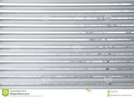 semi closed metallic blinds on a window royalty free stock photos