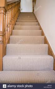 Banister House Britain Uk View Up Staircase With Plain Stair Carpet And Wooden