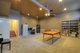 basement with ceiling fan u0026 carpet in houston tx zillow digs