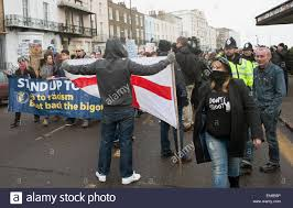 a britain first activist confronts the anti ukip march at the