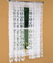 Window Treatment Hardware Medallions - add texture to an all white room with open weave lace curtains