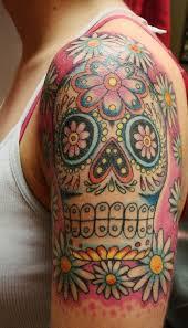 coloured sugar skull on shoulder tattoos