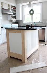 how to add trim to bottom of kitchen cabinets kitchen island makeover with beadboard