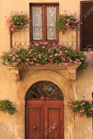 flowers on a european balcony stock photo picture and royalty