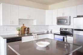White Kitchen Cabinets Lowes Kitchen White Flat Front Cabinets Grey Quartz Countertops Square