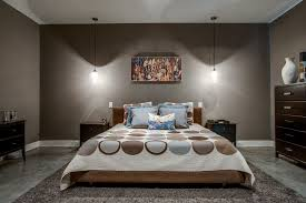 modern master bedroom with pendant light by classic urban homes