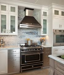 white kitchen cabinets with stainless steel backsplash stainless steel backsplash shelf with black and frosted