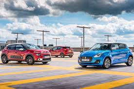 nissan micra used car review suzuki swift vs nissan micra vs citroen c3 triple test review by