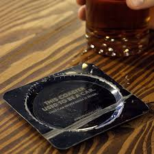 local bar has metal coasters made from cars wrecked in drunk