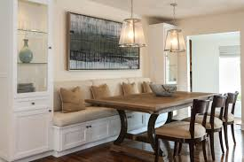 beige kitchen banquette wood flooring white cabinets with glass