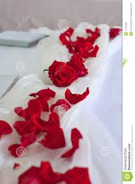 wedding room decoration with red roses in the wedding bed