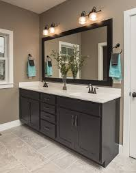 bronze faucets on white sink butcher block counters with bronze