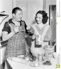 couple together in the kitchen baking a cake stock photo image