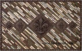 kitchen medallion backsplash 5 fleur de lis backsplash metal and mosaic tile medallion