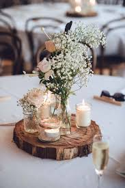 table decorations a relaxed garden soiree wedding in kiama tree trunks wedding