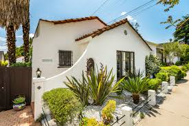 mid city spanish style with summer ready backyard asks 879k
