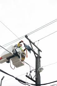 this comed overhead lineman is fixing a power line that has gotten