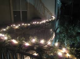 exterior great garland lights at black metal fence for