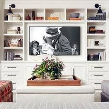 livingroom cabinets feminine chicago condo tour shelving entertainment and