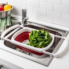 over the sink colander ksp stretch over the sink colander red kitchen stuff plus