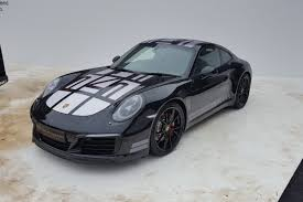 porsche headlights at night porsche 911 endurance racing edition breaks cover at a muddy
