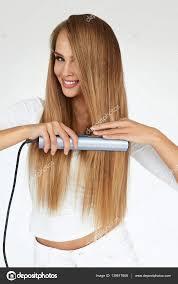 Frisuren Lange Haare Br Ett frau ein bügeleisen brett lange glatte haare mit glätteisen