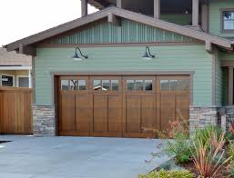 craftsman style garages shallow gooseneck light complements arts crafts style home